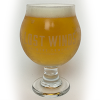 Chalice glass filled with a lighter looking dark beer from Lost Winds Brewing near Coastal San Clemente