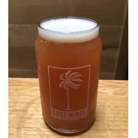 Half Pipe Haze is served in a beer can glass filled with a darker bodied unfiltered red-ish beer from Lost Winds Brewing in near San Juan Capistrano, California