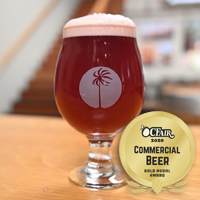 Blackberry Trails is served in a tulip glass filled with a red fruity-looking beer from Lost Winds Brewing Company near the west coast of San Clemente