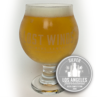 Award from Los Angeles International Beer Competition. Chalice glass filled with a lighter looking dark beer from Lost Winds Brewing in Orange county, California
