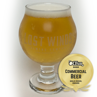 Gold Medal winner from OCFair 2020 Commercial Beer. Chalice glass filled with a lighter looking dark beer from Lost Winds Brewing near San Onofre, California