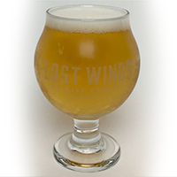 Unstable Table is served in a chalice glass filled with a light beer from Lost Winds Brewing in San Clemente, California